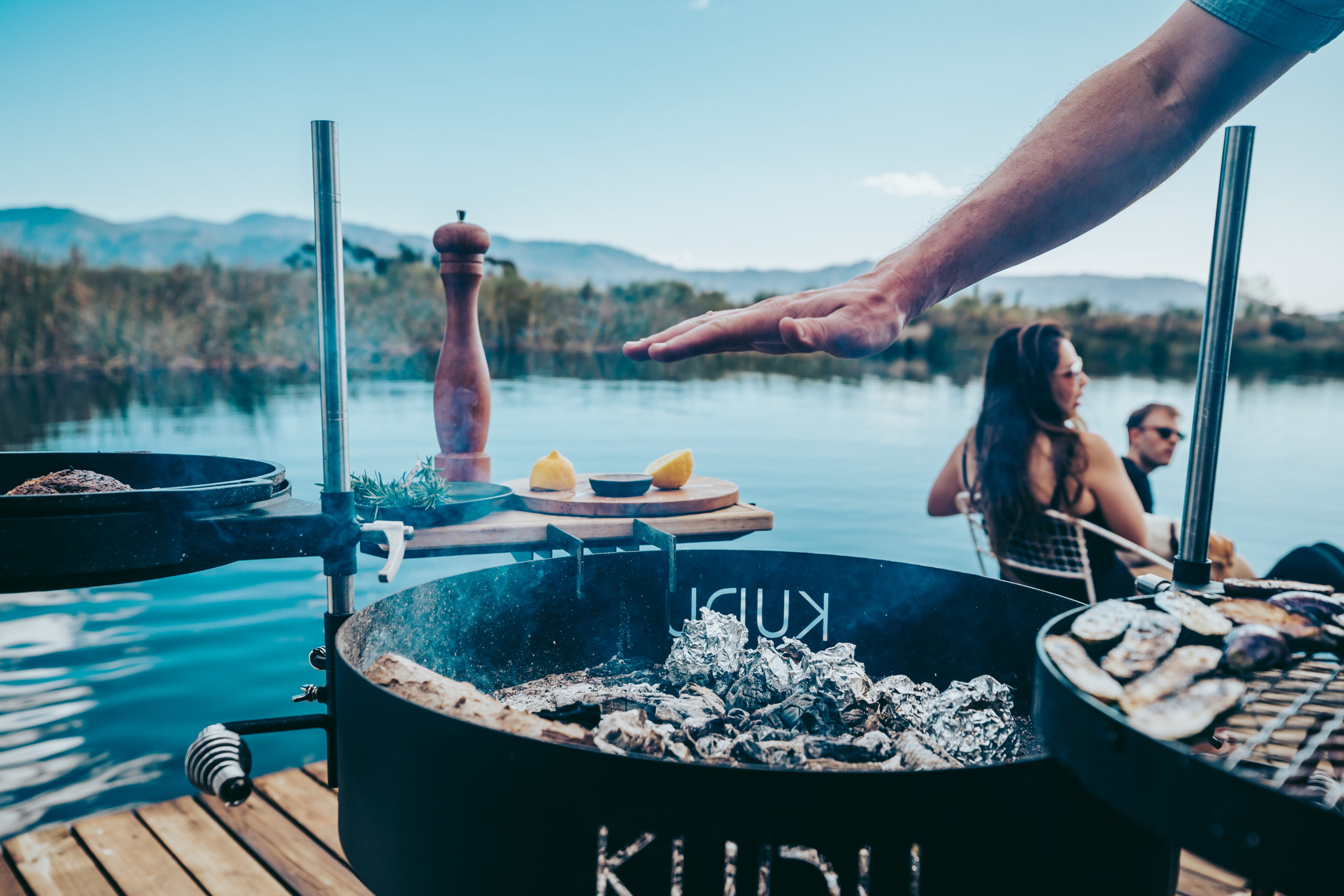 KUDU cooking grill with coals ready to grilll